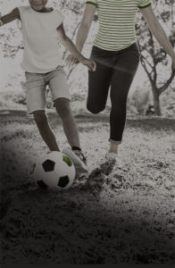 mother and daughter playing soccer